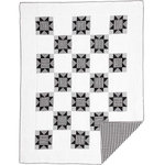 VHC Brands - Emmie Twin Quilt - An on trend yet classically styled look for the modern farmhouse, the Emmie Twin Quilt captures attention with contrasting black and white, creating a statement look for your bedroom. The heart of this quilt is an 8-point star set within a patchwork block of checks, microchecks and ticking stripes. Hand-quilted, 100% cotton. Coordinates perfectly with Annie Black accessories.