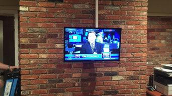 TV on a brickwall