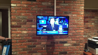 TV on a brickwall
