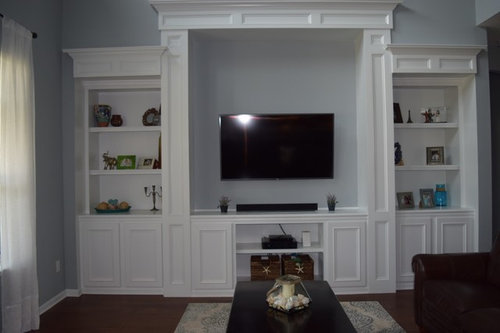 Should kitchen cabinets match living room built in