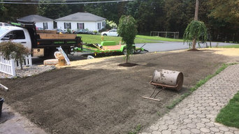 New lawn and two ornamental trees