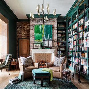 Ejemplo de despacho ladrillo, tradicional renovado, grande, ladrillo, con paredes verdes, suelo de madera en tonos medios, todas las chimeneas, escritorio independiente, suelo marrón y ladrillo