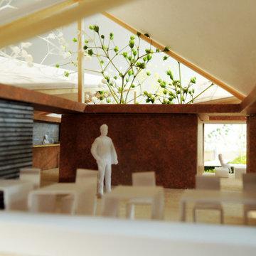 カフェの内部空間。身の回りは籠もった場所、その上は空や緑に開放された籠もった感と開放感が同居する空間です。
