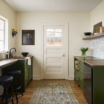 Inspiration for a small timeless single-wall medium tone wood floor and brown floor kitchen pantry remodel in Chicago with an undermount sink, open cabinets, medium tone wood cabinets, wood countertops, gray backsplash, marble backsplash, black appliances and brown countertops