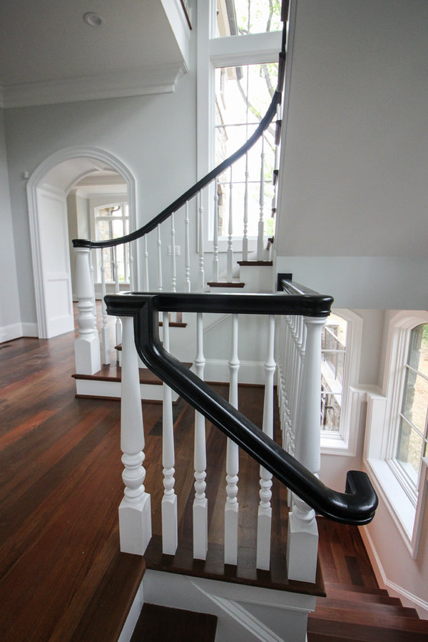 Powerful Impression by Floating Staircase in Suburban Foyer