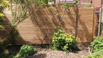Slatted cedar fence panel