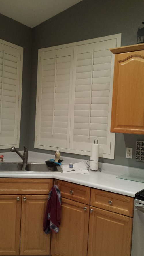 Kitchen Cabinets Next To White Shutters