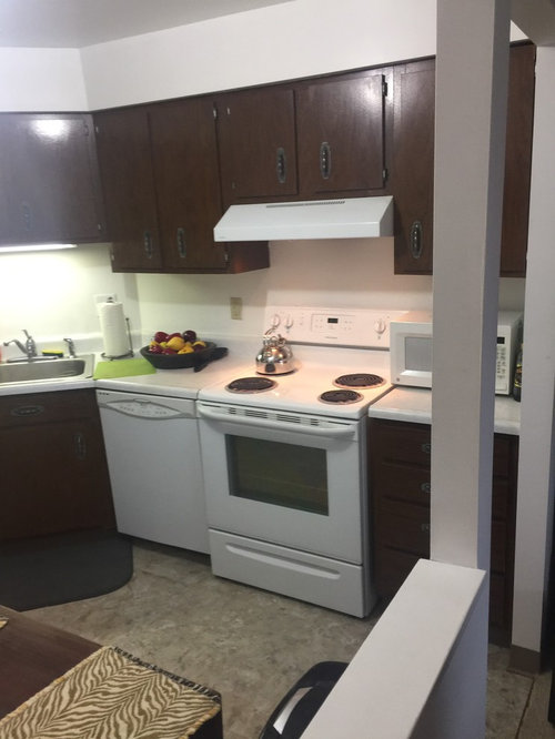 Cabinet refacing--light gray with granite countertops