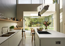 I love the kitchen  units and the beautiful wall light.