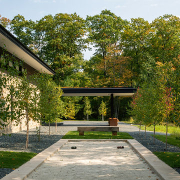 Modern Northwoods Residence Arrival Exterior & Bocce Court