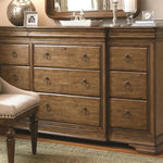 Universal Furniture - Drawer Dresser - Twelve drawers including three hidden within the top frame and one drop front media drawer; Jewelry tray inserts; Hidden drawers on ends; Cedar bottoms in bottom drawers