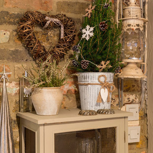 Cottage chic home design photo in London