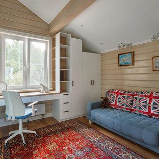 На фото: рабочее место в стиле рустика с встроенным рабочим столом, паркетным полом среднего тона, балками на потолке, сводчатым потолком и деревянными стенами без камина с
