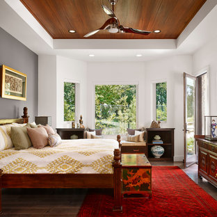 Asian medium tone wood floor bedroom photo in Austin with white walls and no fireplace