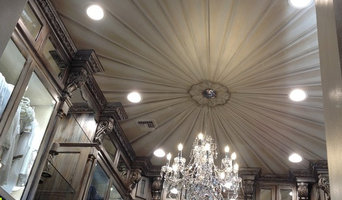 Tarnished silver cabinets, trompe l'oeil ceiling