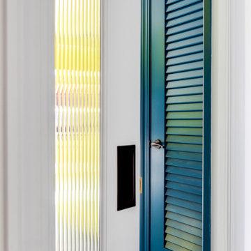 Blue Jewel Toned Laundry Room Linen Closet Door