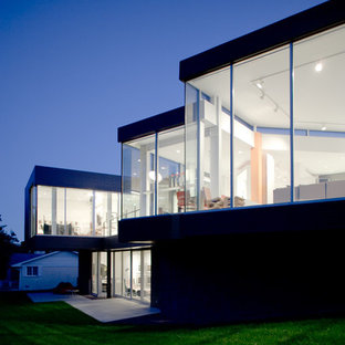 Modern two-story glass exterior home idea in Kansas City