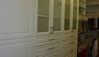 White closet with fluted glass doors