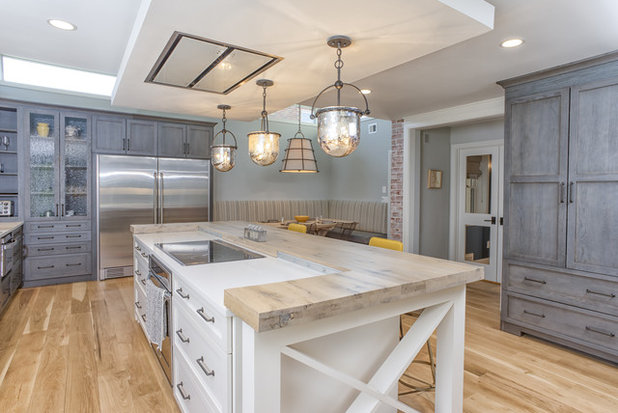 Otis set the stove vent in a floating soffit that sits a foot lower than  the room's 9-foot-high ceiling to define the island and make it a more  intimate ...