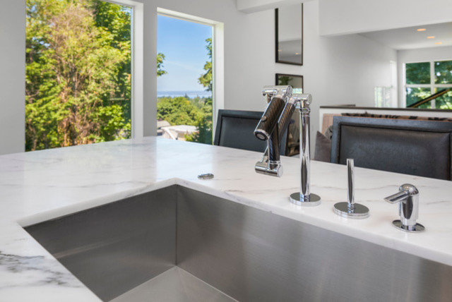 A Thoughtful Kitchen With a Range Hood Composed of Primer Stucco