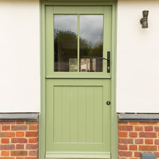 Timber Stable Door With Green Exterior And White Interior Front Doors