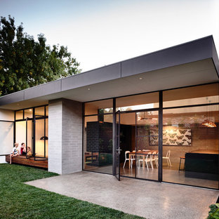 Example of a trendy home design design in Melbourne