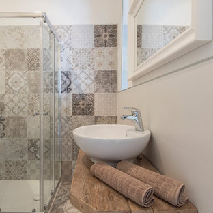 Inspiration for a mid-sized eclectic 3/4 multicolored tile and porcelain tile light wood floor and beige floor bathroom remodel in Milan with open cabinets, light wood cabinets, a two-piece toilet, white walls, a vessel sink and wood countertops