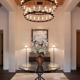 Mid-sized eclectic dark wood floor entryway photo in San Francisco with white walls and a white front door