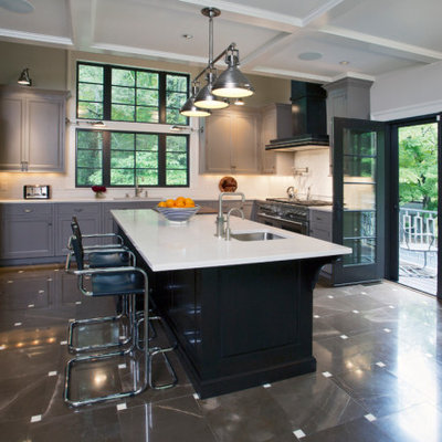 Example of a large classic u-shaped ceramic tile, multicolored floor and coffered ceiling eat-in kitchen design in New York with an undermount sink, recessed-panel cabinets, gray cabinets, quartz countertops, white backsplash, ceramic backsplash, stainless steel appliances, an island and white countertops