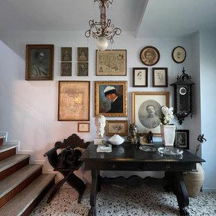 Esempio di un ingresso boho chic di medie dimensioni con pareti grigie, pavimento alla veneziana, una porta singola, una porta in legno scuro, pavimento grigio e pannellatura