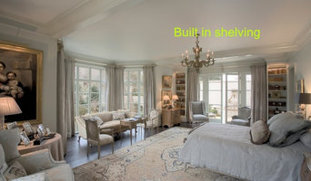 Built In bookcases flank the french doors