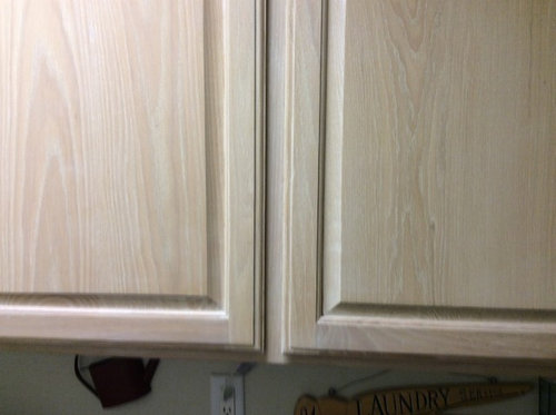Tired, outdated, whitewashed, oak cabinets.