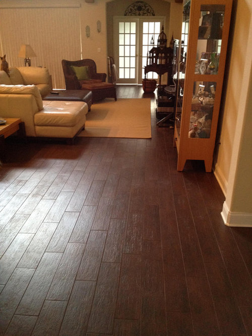 Contemporary living room idea in Tampa - Ceramic Wood Flooring Houzz