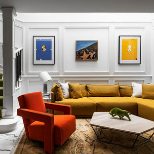 Mid-sized eclectic formal loft-style living room in Melbourne with white walls, porcelain floors, a wall-mounted tv, multi-coloured floor and decorative wall panelling.