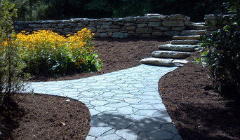 Boulder retaining wall with Belgard paver walkways
