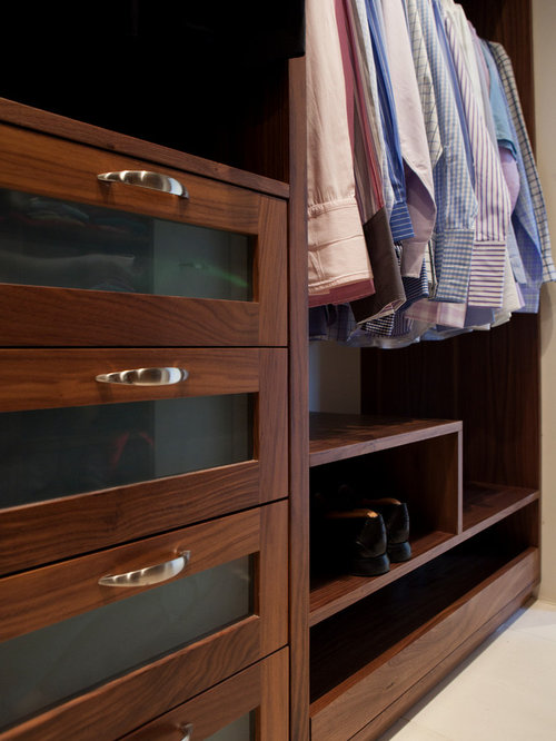Closet Design Ideas, Remodels & Photos with Dark Wood Cabinets and ...