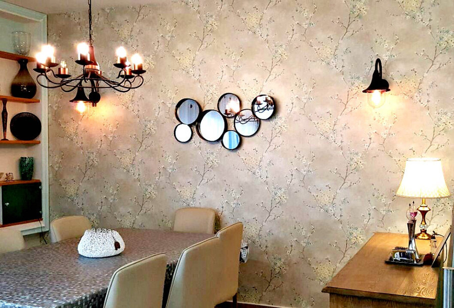 dining room with amazing wallpaper/ bronze lights/wall mirrors