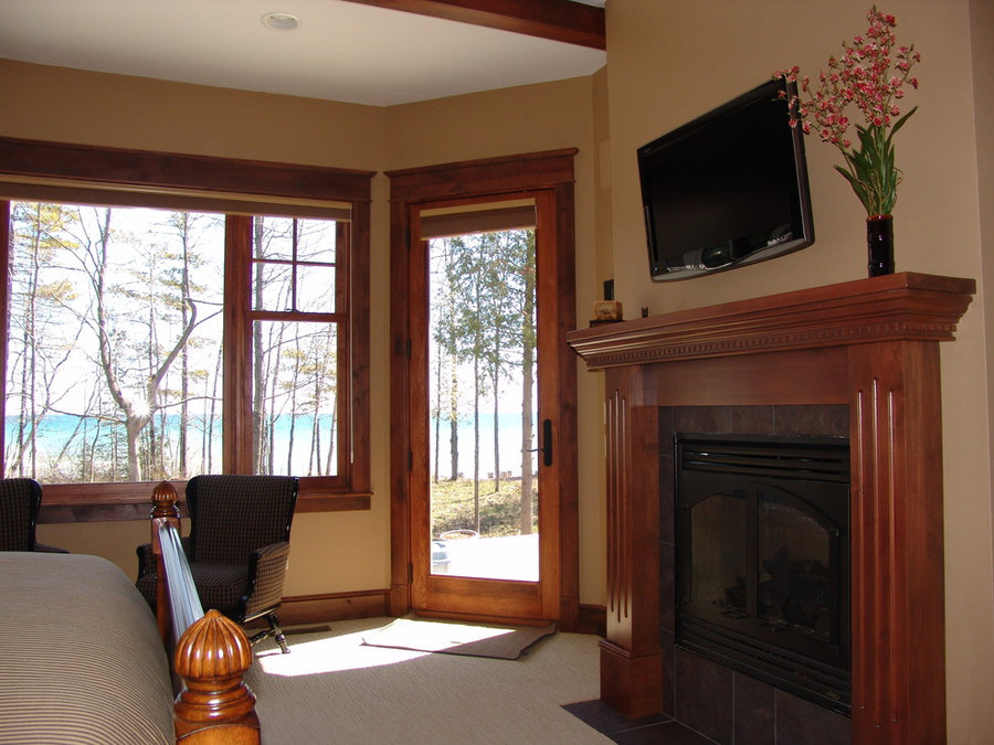 Warm and Cozy Master Bedroom with Large Windows
