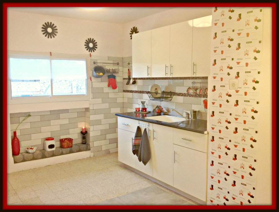 white/blk/red kitchen with funky wallpaper