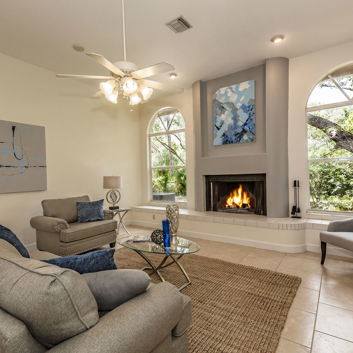 Family Room Staging in a Custom Home in the exclusive Foxfire West neighborhood in Sarasota, Florida. Staging design by Doshia Wagner, Photography and Artwork by Christina Cook Lee.