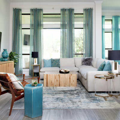 Example of a beach style family room design in Austin