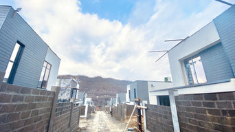 Отделка фасадов коттеджного поселка