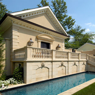 Inspiration for a mid-sized timeless backyard rectangular lap pool remodel in DC Metro