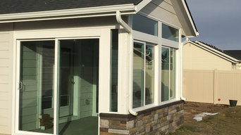 Sunroom with an exterior rock wall