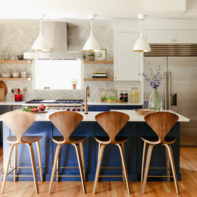 Inspiration for a large transitional l-shaped medium tone wood floor and brown floor enclosed kitchen remodel in Denver with recessed-panel cabinets, blue cabinets, gray backsplash, porcelain backsplash, stainless steel appliances, an island and white countertops