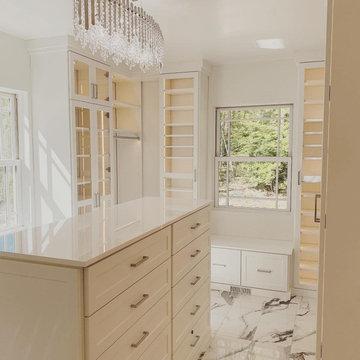White Custom Walk-in Closet With Marble Floors