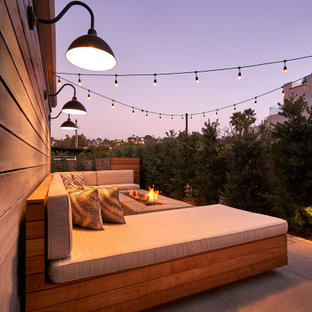 Inspiration for a small contemporary back patio in San Diego with a fire feature, natural stone paving and no cover.
