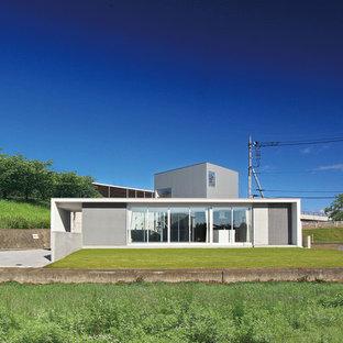 他の地域, のコンテンポラリースタイルのおしゃれな家の外観の写真