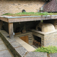 woodfired oven under a green roof