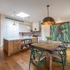 Room of the Week: A Colourful Wood Kitchen With Art at its Heart
